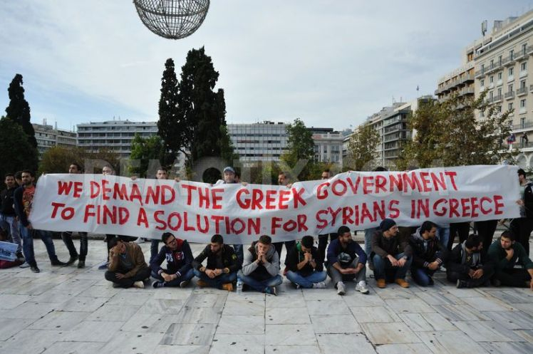 1416426453-syrian-refugees-in-greece-demand-asylum-and-shelter_6295720